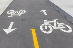 Two-way bike lane on a newly paved pathway.