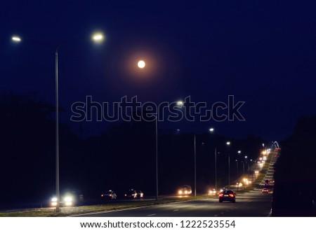 Two way road illuminated by the light post at night, chisinau, moldova #1222523554