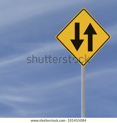 Two way road sign on a blue sky background with copy space