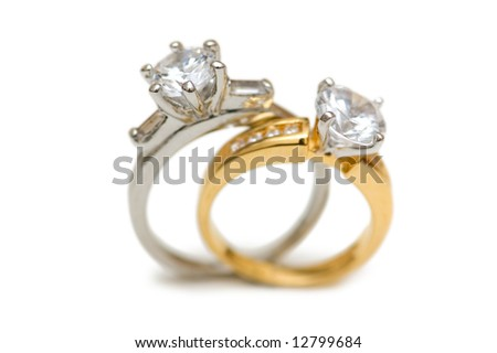 Two wedding diamond rings isolated on white
