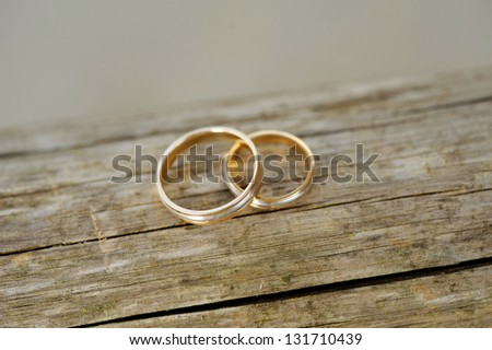 two wedding golden on wooden surface