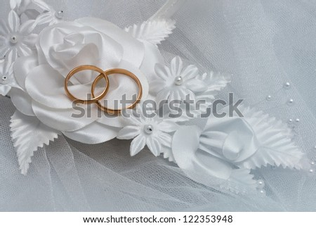 Two wedding rings and wedding background.
