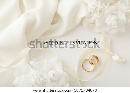 two wedding rings and wedding invitation #1091784878