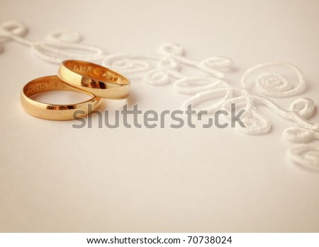 stock photo two wedding rings and wedding invitation