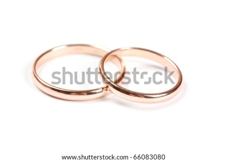 Two wedding rings isolated on a white background