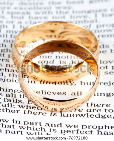 stock photo Two wedding rings on a bible