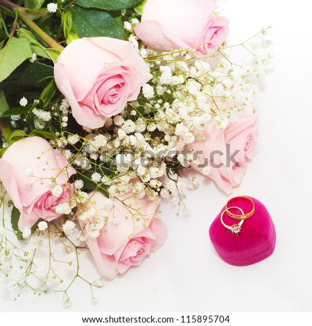Two Wedding Rings on a pink box and Rose
