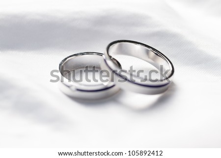 Two weddings rings on a background a fabric