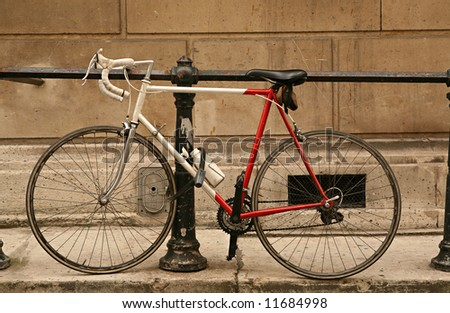 Two-wheeled bicycle parked in city street