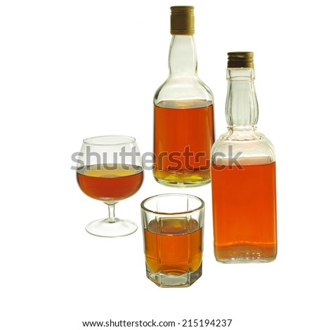 Two whiskey bottle and two glasses. Isolated on white background #215194237