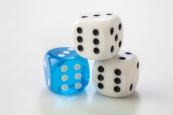 two white and one blue dice on white background