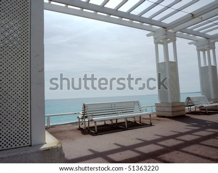 Two white benches in front of mediterranean sea at Nice, France