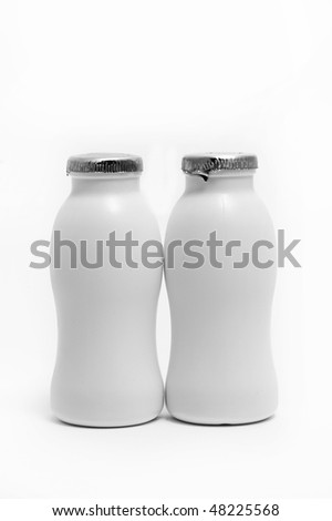 two white bottles isolated on a white background