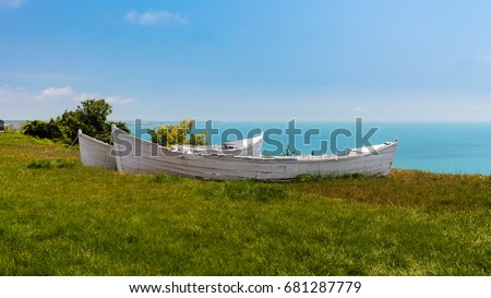 Two white broken old boats on the grass, view from altitude to the sea, black sea coast in Bulgaria. #681287779