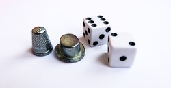 Two white dice and game chips for Monopoly