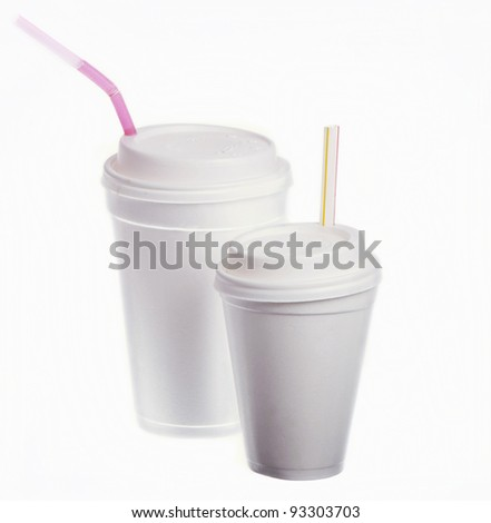 Two white disposable glasses with tubules on a white background