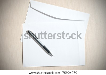 Two white envelopes with pen