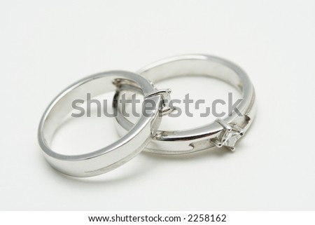 stock photo Two white gold wedding rings on silver background