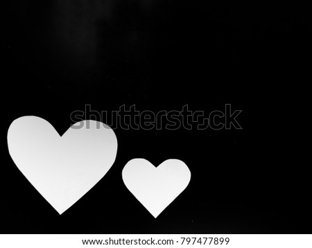 two white hearts on blackgound with copy space #797477899