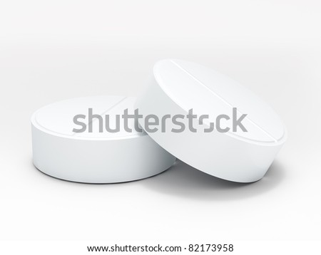 Two white medical pills on white background