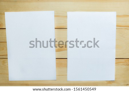 Two white mockup blanks on wooden background. Flat lay, top view, copy space #1561450549