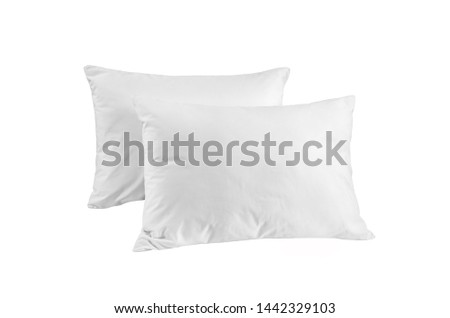 Two white pillows isolated, pillows on a white background, two pillows piled against white background. Top view.