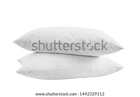 Two white pillows isolated, pillows on a white background, two pillows stacked against white background. Side view.