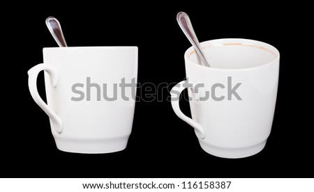 Two white plastic tea cups with teaspoons isolated on black
