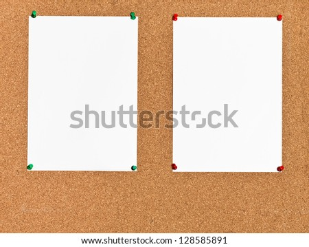 two white sheets of paper on cork board