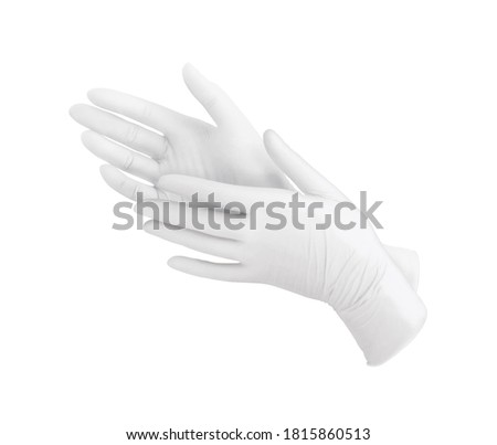 Two white surgical gloves isolated on white background with hands. Medical nitrile gloves. Rubber glove manufacturing, human hand is wearing a latex glove. Doctor or nurse putting on protective gloves