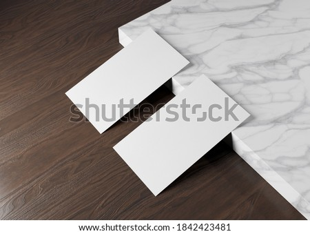 Two white US business card Mockup on wooden background. American size calling card front and back laying on blank surface 3D rendering Foto stock ©