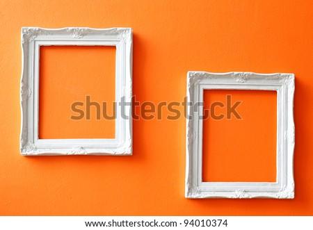 two white vintage frames on...
