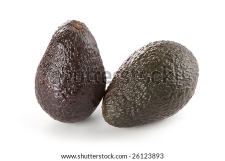 Two whole hass avocados isolated on white background