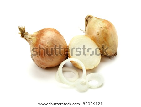 two whole onions, one half onion and onion rings on white background