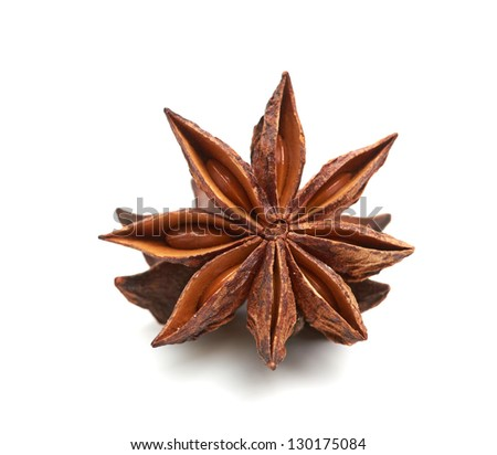 two whole star anise isolated on white background