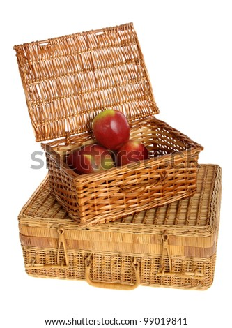 two wicker baskets with apples