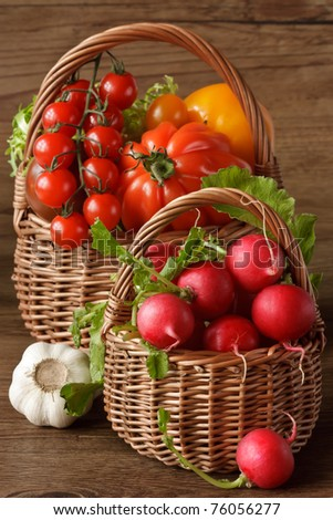 Two wicker baskets with fresh garden vegetables.