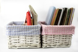 two wicker boxes for storage with different items