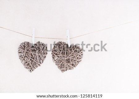 Two wicker hearts hanging on cord