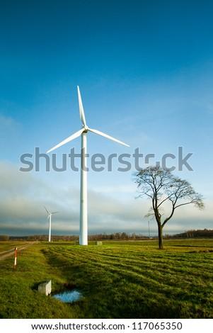 Two wind electric generators in field