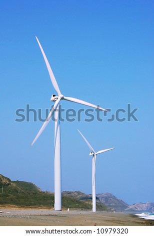 two wind turbines in a windfarm in the philippines