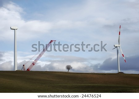 Two wind turbines, one complete and one under construction