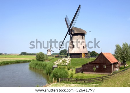 Two windmills in the countryside near Amsterdam, the Netherlands