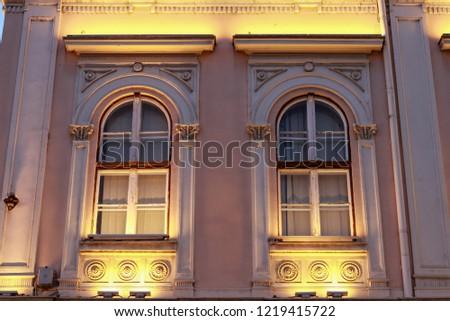 Two windows of the building illuminated by night illumination #1219415722