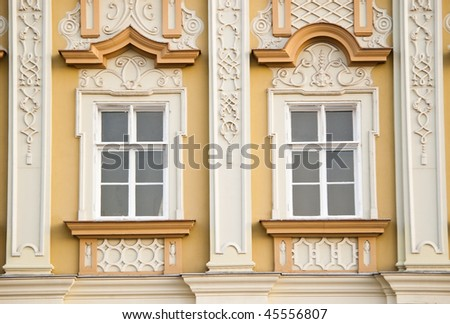 two windows on classic building