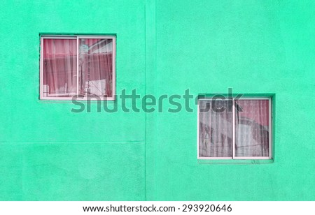 Two windows on orange wall in Valparaiso - Chile, South America