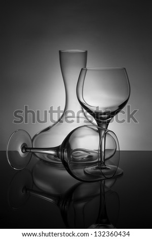 Two wine glasses and a decanter in black and white