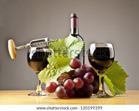 two wine glasses, bottle red wine with grape and leafs - stock photo