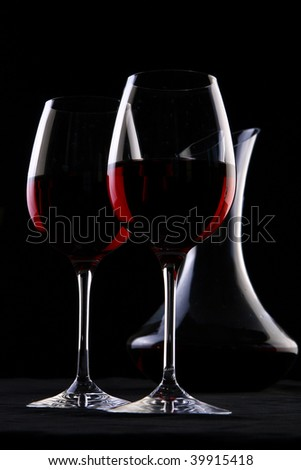 two wine glasses on black