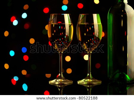 Two wine glasses on holiday background